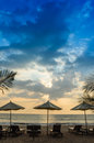 Silhouettes of beach umbrellas sunset and sky thailand Royalty Free Stock Image