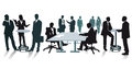 Silhouettes of business people at the office Royalty Free Stock Photo