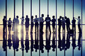 Silhouettes of Business People Working Together Royalty Free Stock Photo