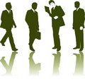 Silhouettes of businessmen Stock Images