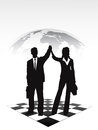 Silhouettes of businessmen on a chessboard pictures show group the background the planet Royalty Free Stock Photo