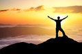 Silhouettes of champion on mountain peak sport and active life concept Stock Photography