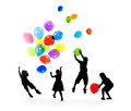 Silhouettes of Children Playing Balloons Together Royalty Free Stock Photo