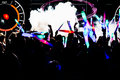 Silhouettes of concert crowd in front of bright stage lights with confetti Royalty Free Stock Photo