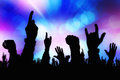 Silhouettes of concert crowd hands supporting band on stage Royalty Free Stock Photo