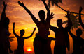 Silhouettes of diverse multiethnic people partying Stock Photo