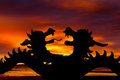 Silhouettes of dragons against a red sunset Stock Photography