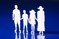 Silhouettes family members holding hands together Royalty Free Stock Photo