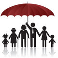 Silhouettes of family under umbrella cover Stock Images