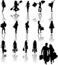 Silhouettes of girls in shopping Royalty Free Stock Photos