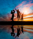 Silhouettes of happy family Royalty Free Stock Photo