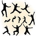 Silhouettes of jumping people Royalty Free Stock Photography