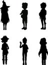 Silhouettes of kids in halloween suits Stock Images