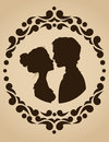 Silhouettes of kissing couple in an ornate frame Stock Photography