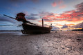 Silhouettes of longtail boat and sunrise in phuket thailand Stock Photos