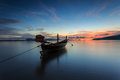 Silhouettes of longtail boat and sunrise in phuket thailand Royalty Free Stock Photos