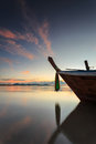 Silhouettes of longtail boat and sunrise in phuket thailand Stock Photography