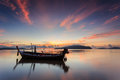 Silhouettes of longtail boat and sunrise in phuket thailand Royalty Free Stock Images