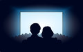 Silhouettes a loving couple at movie theater Royalty Free Stock Photo