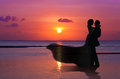 Silhouettes Married Couple on sunset Royalty Free Stock Images