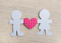Silhouettes of men, women and heart cut out of paper Royalty Free Stock Photo