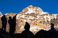 Silhouettes of Mountain Climbers staying against high Peaks