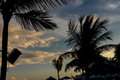 Silhouettes of palms during tropical sunset on paradise island Bali, Indonesia. Royalty Free Stock Photo