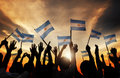Silhouettes of People Holding Flag of Argentina Royalty Free Stock Photo