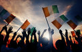 Silhouettes of People Holding Flag of Ireland Royalty Free Stock Photo