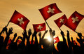 Silhouettes of People Holding Flag of Switzerland Royalty Free Stock Photo