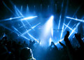 Silhouettes of people and musicians in big concert stage bright beautiful rays light Stock Photo