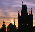 Silhouettes of Prague towers at dawn Stock Photos