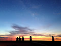 Silhouettes of three people at sunset Royalty Free Stock Photo