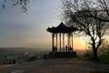 Silhouettes of tourists and a Chinese Gazebo at sunset. Pyatigorsk Royalty Free Stock Photo