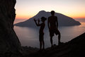 Silhouettes of two people having fun at sunset Royalty Free Stock Photo