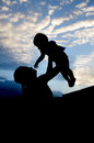 Silhouettes of the women and child in the evening Royalty Free Stock Photo