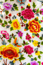 Silk embroidery flowers beautiful with vivid on white textile background close up of traditional south korean clothes Royalty Free Stock Photography