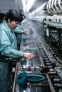Suzhou, China - May. 10, 2016: workers in silk factory, Mrs Lieu