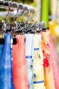 Silk scarfs on hangers in retail boutique shop