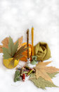 Silk threads against candles fabric and autumn leaves Stock Photos