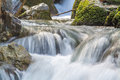 Silky smooth flowing water exposed long to get motion blur over Stock Photo