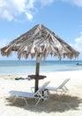 Sillas de salón en la playa Imagen de archivo libre de regalías