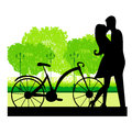 Sillhouette of sweet young couple in love standing in the park Royalty Free Stock Images