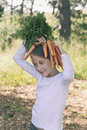 Silliness with carrots making a hat the children do these fun things Stock Photo