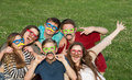 Silly costumed teens happy group of five teenagers in costume Royalty Free Stock Images