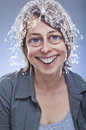 Silly and crazy young woman with splashed water on deformed head.The photo has a digital retouching eyes and mouth Royalty Free Stock Photo