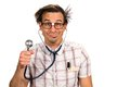 Silly nerdy doctor with a facial expression holds up a stethoscope Royalty Free Stock Images
