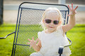 Silly Playful Toddler Girl Wearing Sunglasses Outside at Park Royalty Free Stock Photo