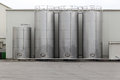 Silo stainless steel for storing bulk materials in factory Stock Image