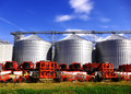 Silos and agricultural machinery Stock Photo